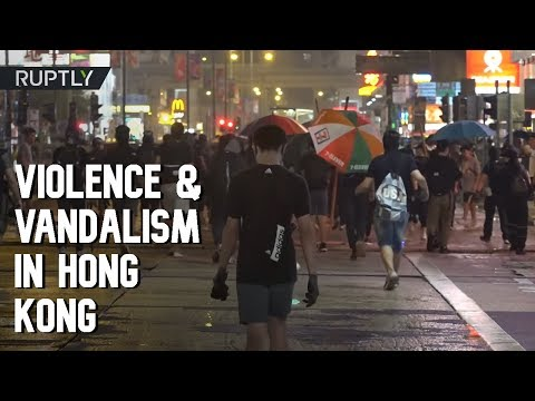Violence and vandalism as protesters defy mask ban in Hong Kong