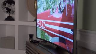 """Samsung 4K UHD 120Hz Curved LED Smart TV 