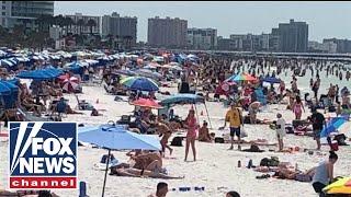 Florida governor under pressure to shut down state's beaches