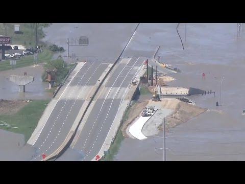 Floodwaters rise above highway signs in Missouri