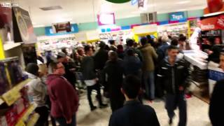 Shoppers fighting over cheap tv's in Tesco, Bristol