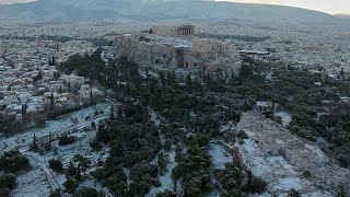 Watch: Athens awakes to winter wonderland