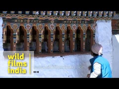 Pilgrims turn prayer wheels in Kyichu Lhakhang, Bhutan