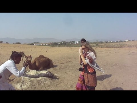 Villager Welcoming a Foreign Tourist in Pushkar , Ajmer, Rajasthan Tourism, India