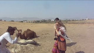 villager welcoming a foreign tourist in pushkar ajmer rajasthan tourism india tour