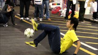 Hong Kong. Football Acrobat in the Street of Mong Kok, Kowloon