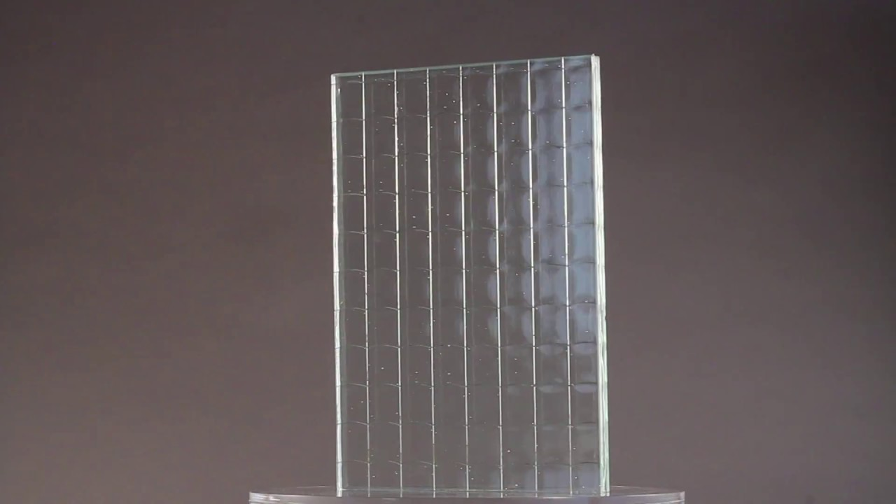 Wire mesh laminated between low iron glass. - YouTube