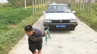 Amazing footage of boy strong enough to pull a car