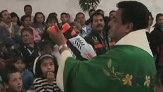 Priest Squirts Holy Water Gun at Congregation