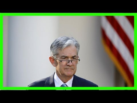 Fed nominee jerome powell defends bank regulation, sees higher us interest rates