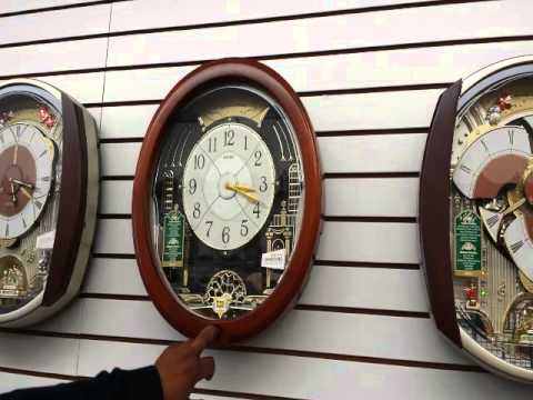 Paul Tyson Jr. prices the musical clocks at Tyson & Co. Jewelers in Port Chester.