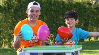 Jason and Alex on bunny toys eggs