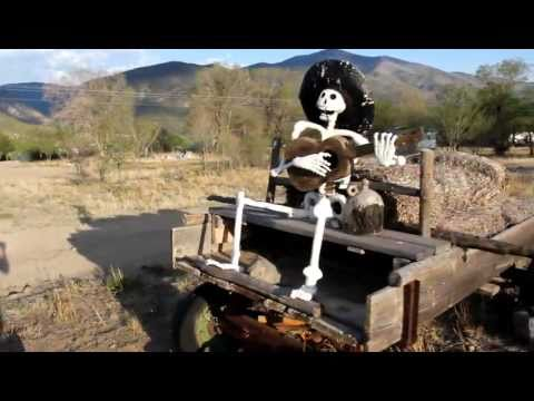 Death rides a wagon and plays guitar in Questa, New Mexico