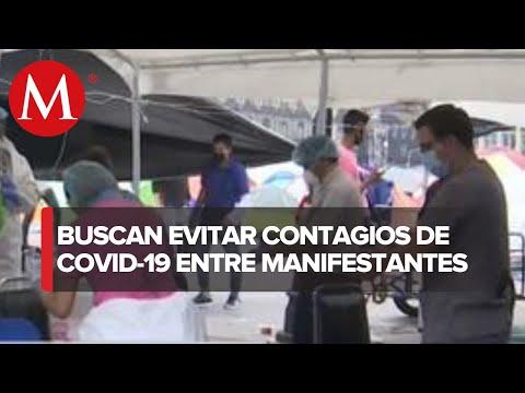 Gobierno de la CdMx realiza jornada para detectar casos de covid-19 entre manifestantes del Zócalo