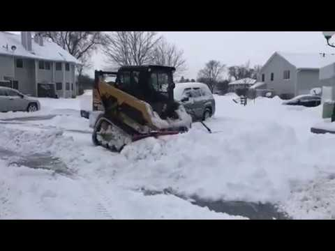 Prowler EXT Rubber Tracks Pushing Snow With CAT 259D Compact Track Loader