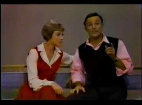 Julie Andrews and Gene Kelly play The Tapping Game… and they sing and dance, because when you have Julie Andrews and Gene Kelly on stage…