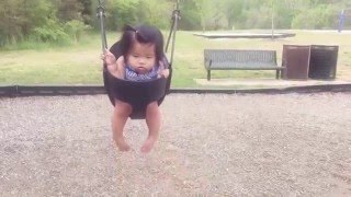 Baby's first time on swing