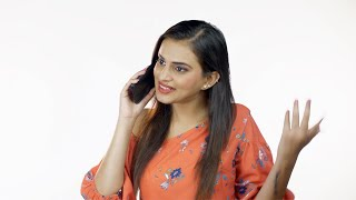 Cheerful Indian girl calling her friend from her smartphone against white background