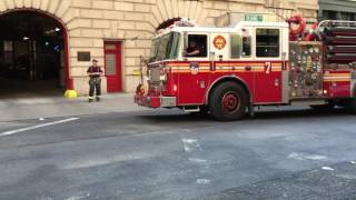 FDNY ENGINE 7 & FDNY TOWER LADDER 1 RETURNING TO QUARTERS ON DUANE ST. IN TRIBECA, MANHATTAN, NYC.