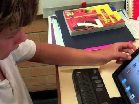 Jake demonstrates the iPad with a refreshable braille display device