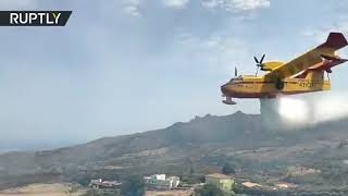 Plane discharges water over out of control forest fire in the Gran Canaria, Spain