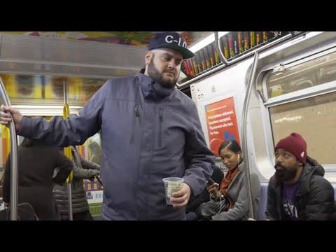 Homeless Train Beggar Gets Bread Shoved In Face