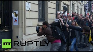 French protesters use chainsaw, battering ram to hack through govt office door
