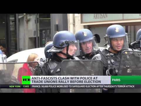 Tear gas, smoke grenades & flares: Violence erupts at Paris protest day before election