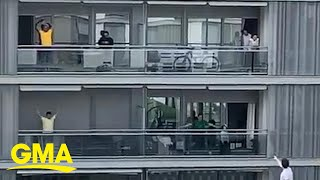 Quarantined residents in Spain take to their balconies for group exercise   GMA Digital