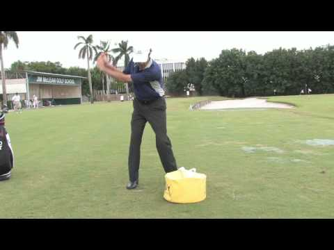 golf-tips-&-lessons-:-practice-golf-with-an-impact-bag