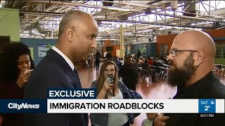 Hamilton man confronts immigration minister in effort to bring stateless girl to Canada