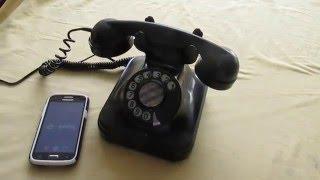 Telefono de disco negro antiguo, funcionando