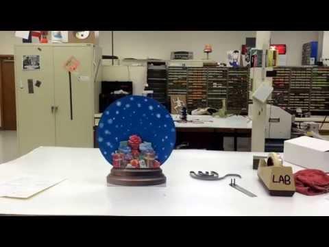 Snow globe motor display