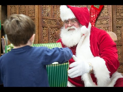 Santa passes out presents to students at Briceville Elementary School