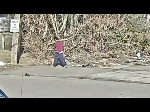 Camera captures man dumping woman's body on Detroit's west side