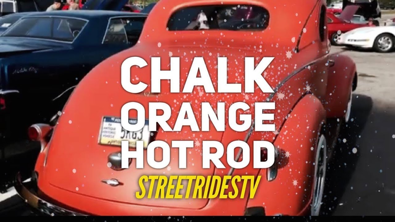 chalk orange flat painted custom hotrod with white wall tires