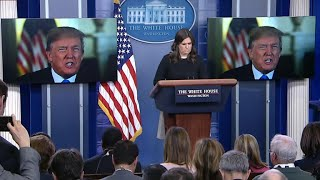 President Trump on-screen appearance at the White House press briefing to praise the recently passed tax bill.