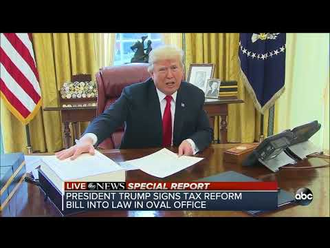 President Trump signs tax reform bill into law in oval office