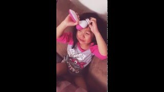 Kid gets electronic face brush stuck in hair