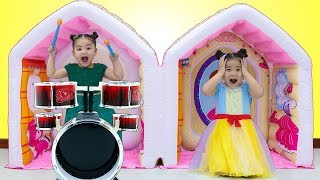Suri and Annie Pretend Play with Inflatable Playhouse