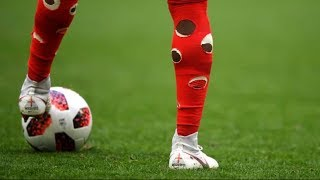 Why do footballers rip holes in their socks? - Oh My Goal