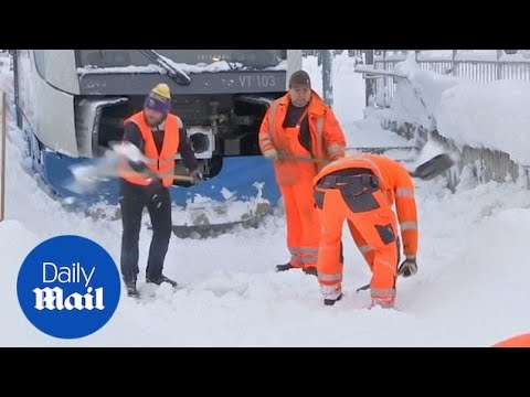 Germany digs out after heavy snowfall causes travel chaos