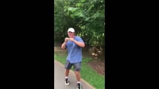 2 guys dancing in the park