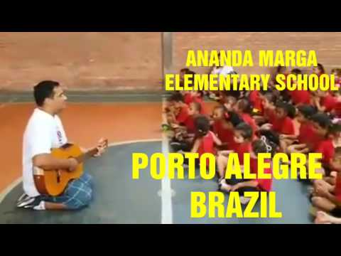 In Brazil, Ananda Marga school kid singing Kirtan