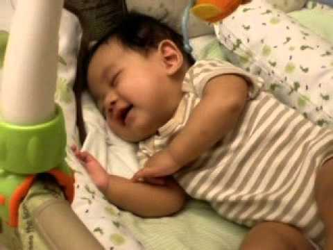 Baby laughing while sleeping :)