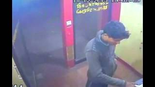 Hacker caught stealing cash from ATM on CCTV