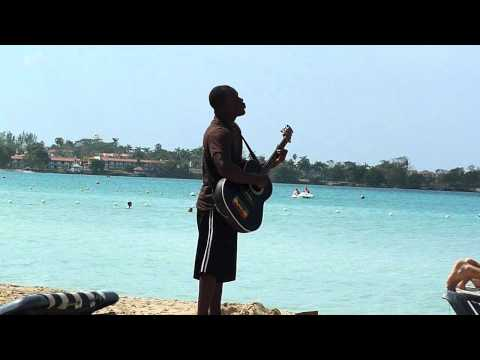 Beach singer on Bloody Bay, Negril