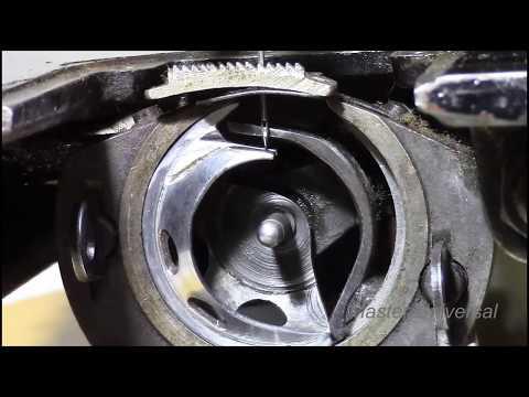 Носик челнока не правильно подходит к отверстию иголки. Видео №409.