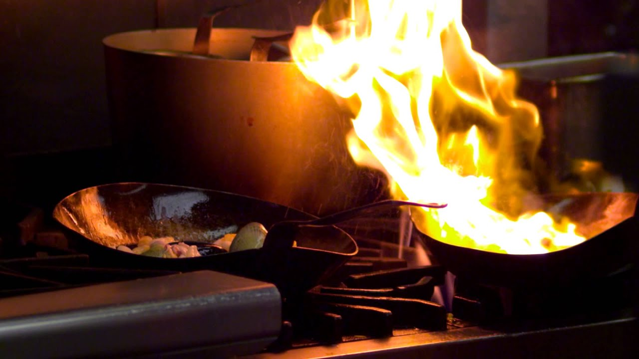 Close Up Of A Chef Cooking Over An Open Flame In Salt Lake City You