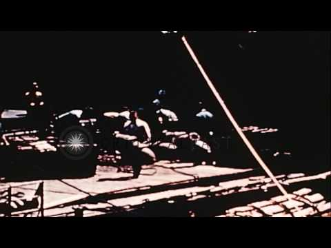 Band plays during refueling of United States ships in the Pacific Theater. HD Stock Footage